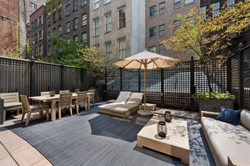 Split level Condo with private outdoor space in the heart of SoHo!